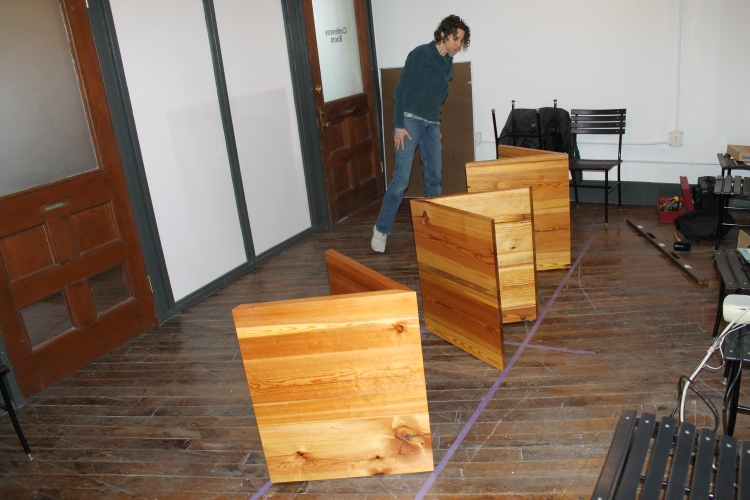 starting the installation - tape on the floor was used to mark the table top and boundaries for pedestals